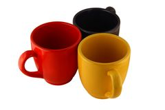 Three mugs. Isolated on pure white royalty free stock images