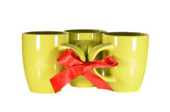 Three mugs. Tied with red ribbon Stock Images