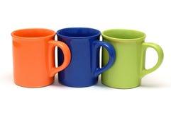 Three mugs Stock Photos