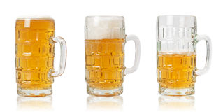 Three Mugs of Beer. Three bear mug in different stages (with clipping path Royalty Free Stock Photo