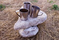 Three mugs on a stone Royalty Free Stock Photography