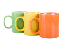 Three multi-colored cups. Stock Photo