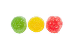 Three multi colored fruit jelly candies on a light background Royalty Free Stock Photos