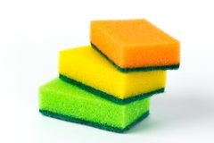 Three multi-colored sponges for washing dishes isolated on white background stock photos