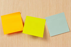 Three multi-colored sticker on wooden board Royalty Free Stock Images