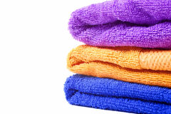 Three multi-colored towels Stock Photos