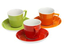 Three multi-coloured cups on a white background Stock Photos