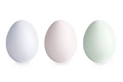 Three multi-coloured eggs on a white Stock Image