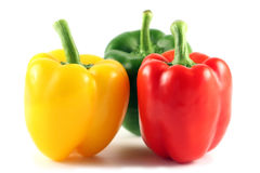 Three multi-coloured pepper. Isolated on white royalty free stock photo