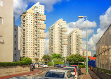 Three multi-story modern residential buildings. Rishon LeZion, Israel-May 27, 2016: Three multi-story modern residential buildings are flooded bright sunlight at royalty free stock photo