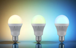 Three multicolor LED bulbs with wireless remote Stock Photo