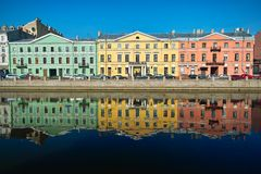 Three multicolor old houses. On the river quay Royalty Free Stock Photography