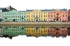 Three multicolor old houses. And their reflection isolated on white background Stock Photo