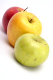 Three multicolored apples in a row stock photography
