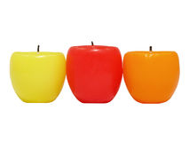 Three multicolored candles. Royalty Free Stock Photo