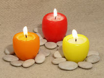 Three multicolored candles. Royalty Free Stock Images