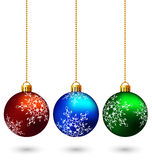 Three multicolored christmas balls isolated on white Stock Images