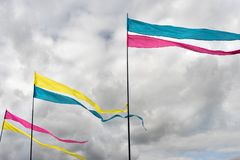 Three multicolored flags against a cloudy sky background Royalty Free Stock Images