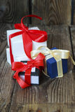 Three multicolored gift boxes with red and yellow ribbons Stock Photography