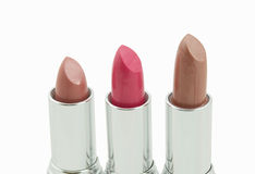 Three multicolored lipsticks Royalty Free Stock Photos