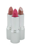 Three multicolored lipsticks, close-up Royalty Free Stock Photography