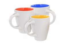 Three multicolored mugs Stock Photos
