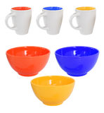 Three multicolored mugs and bowls Stock Image