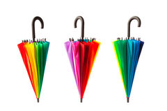 Three multicolored umbrellas on white Stock Photos