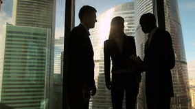 Three multicultural business people starting meeting in office, greeting handshake. Three multicultural business partners starting meeting in office boardroom stock video footage