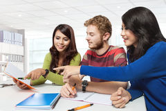 Three multicultural student, studying together Royalty Free Stock Photo