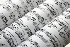 Three music sheets on a row isolated in white. Three music sheets side by side isolated in white Stock Images