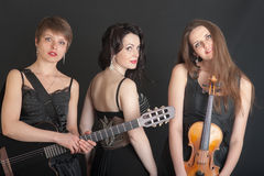 Three musicians Royalty Free Stock Photo