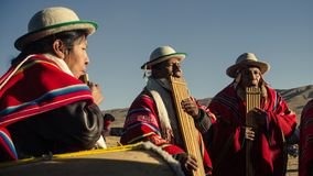 Andean muscians playing for the celebration royalty free stock photography