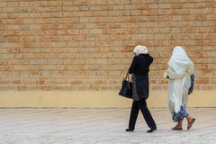 Three muslim woman walking on the street. Of Monastir, Tunisia Royalty Free Stock Photo