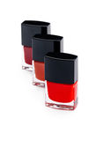 Three nail polish bottles, closeup shot Stock Photos