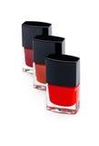Three nail polish bottles, closeup shot Stock Photos