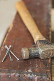 Three Nails and Hammer Royalty Free Stock Photos
