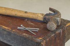 Three Nails and Hammer Royalty Free Stock Images