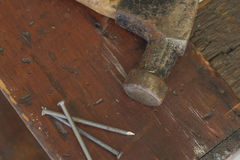 Three Nails and Hammer Stock Photography
