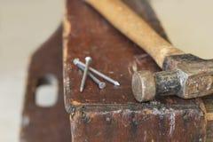 Three Nails and Hammer Royalty Free Stock Photo