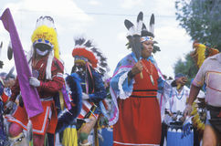 Three Native Americans in full costume performing Royalty Free Stock Photo