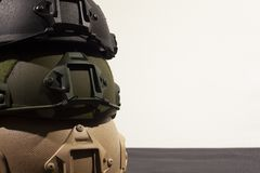 Three nato military helmets on white background. Three Nato military helmet on white background made of booletproof kevlar for better use stock images