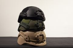 Three nato military helmets on white background. Three Nato military helmet on white background made of booletproof kevlar for better use stock photos