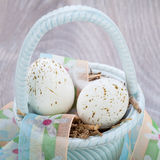 Three natural blue Easter eggs in a basket Stock Photo