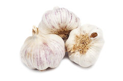 Three natural garlic  on white background Stock Photo