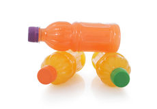 Three neatly stacked fruit drinks Stock Images