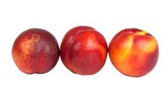Three nectarine. On white background Stock Photo