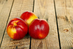 Three nectarines Stock Photo