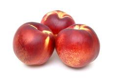 Three Nectarines Stock Photo