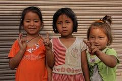 Three Nepali Little girls welcome us Stock Image